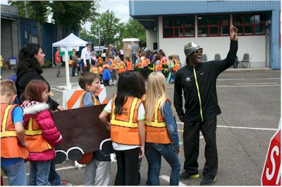 Alphonso, the hip hop traffic cop, explains traffic safety signs to kids